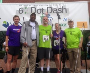Photo of Jessica Beecham, Kevan Worley, Brandon Stepanowich, Anil Lewis, & NFB President Mark Riccobono at the 2016 6 Dot Dash