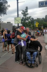 Jessica hugging Kevin, Mom (Marsha), and Kevan at the finish line.